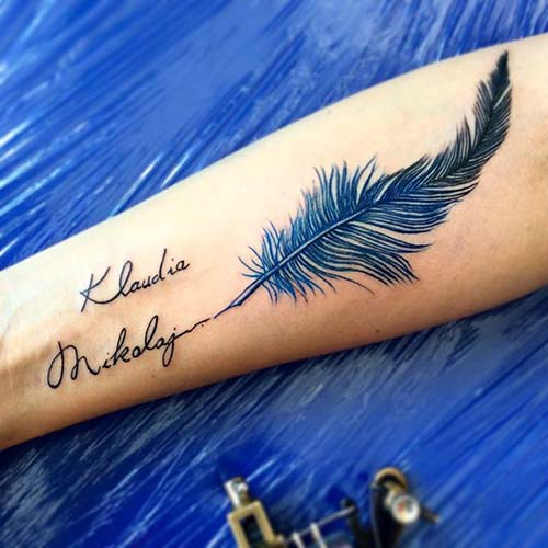 name tattoo with blue feather