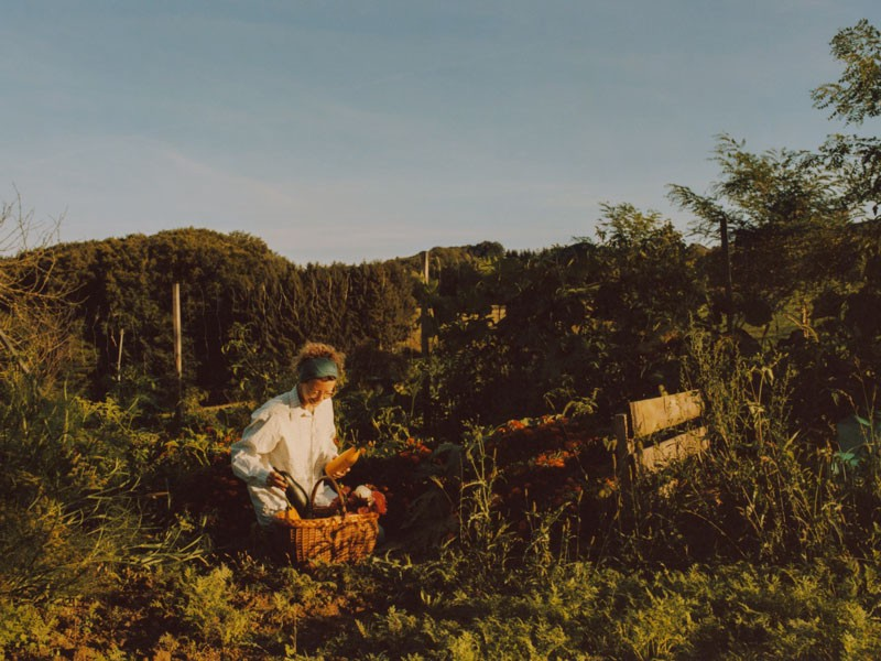 A woman works in a garden.