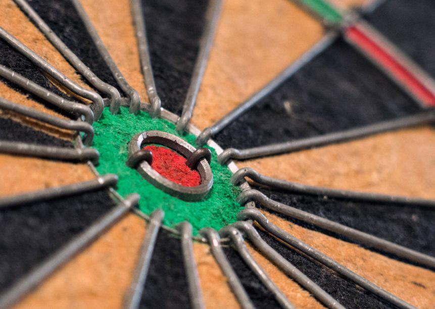 A close-up of the bullseye on a dartboard