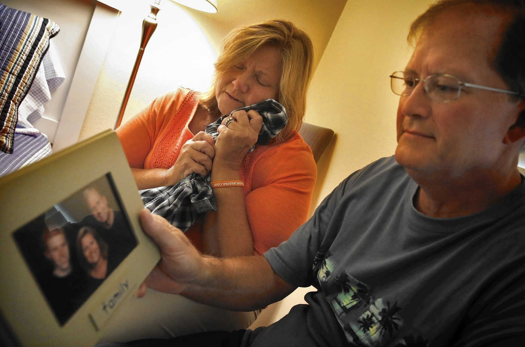 Michael and Karen Laspisa hold a photograph of their missing son Bryce Laspisa in 2015. Photo courtesy of Chicago Tribune.
