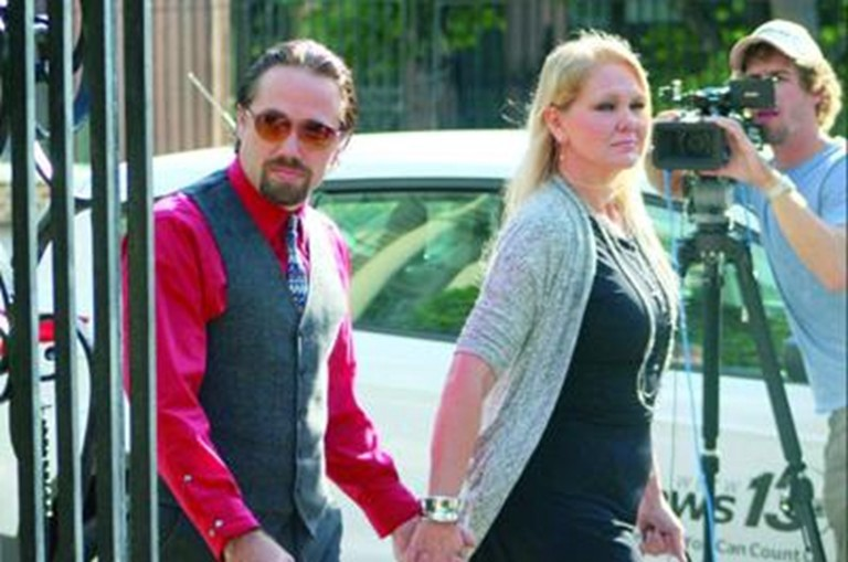 Sidney and Tammy Moorer Tammy Moorer walking into the courthouse.