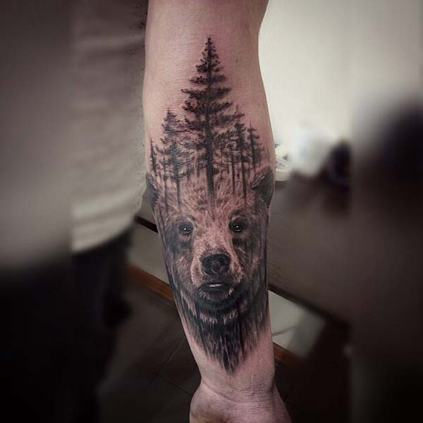 forest and bear tattoo arm