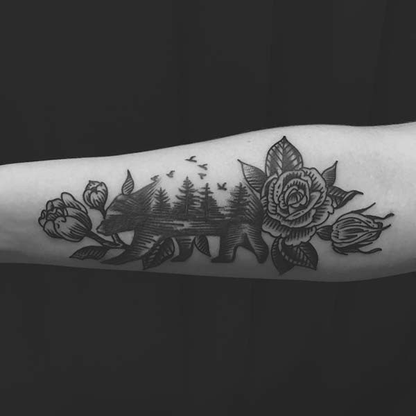 bear and rose inner arm tattoo