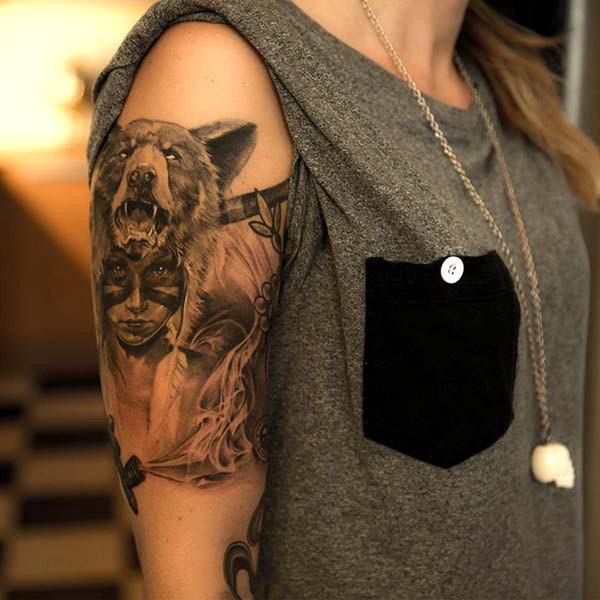 native american woman and bear tattoo on arm lady