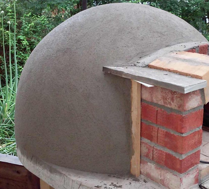 first coat of render on wood fired pizza oven dome