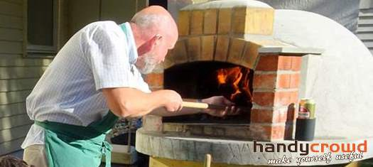 Wood fired pizza oven in action and yes, that's me!