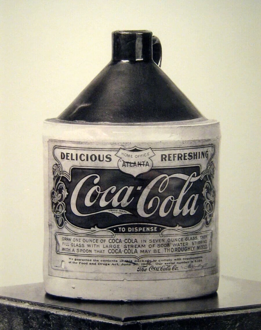 Coka-Cola bottle of syrup to be mixed with carbonated water via a soda fountain