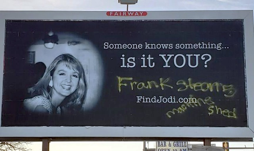 Vandals deface a billboard of missing anchorwoman Jodi Huisentruit with the words ?Frank Stearns Machine Shed? in Mason City.