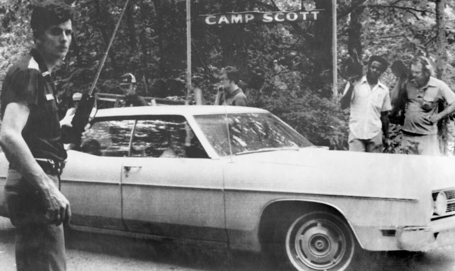 Car with Girl Scouts inside going home after the triple murder at Camp Scott in 1977.