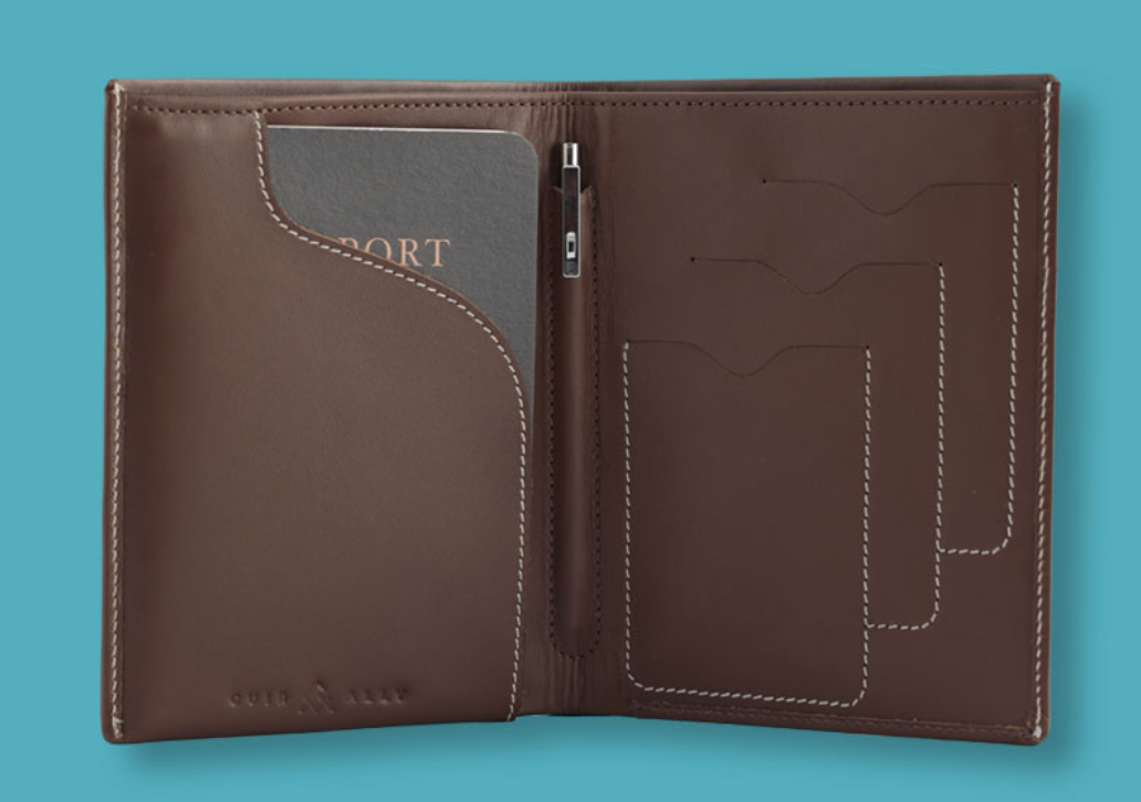 Voyager Smart Wallet open showing mini pen and passport. Smart wallets with GPS tracking.