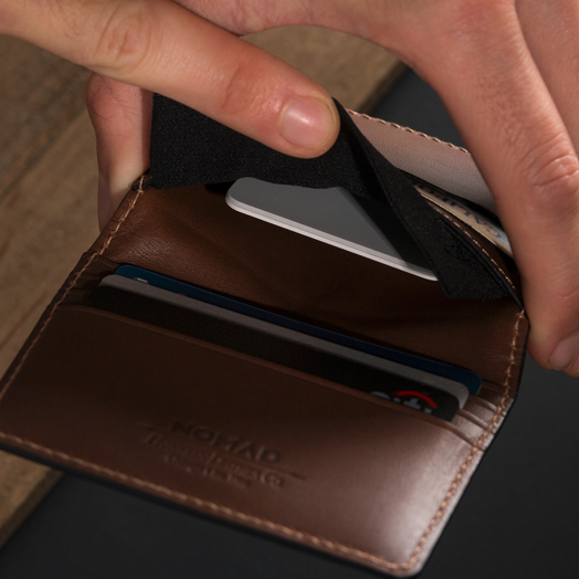 Nomad slim with hidden pocket. Smart wallets with GPS tracking.
