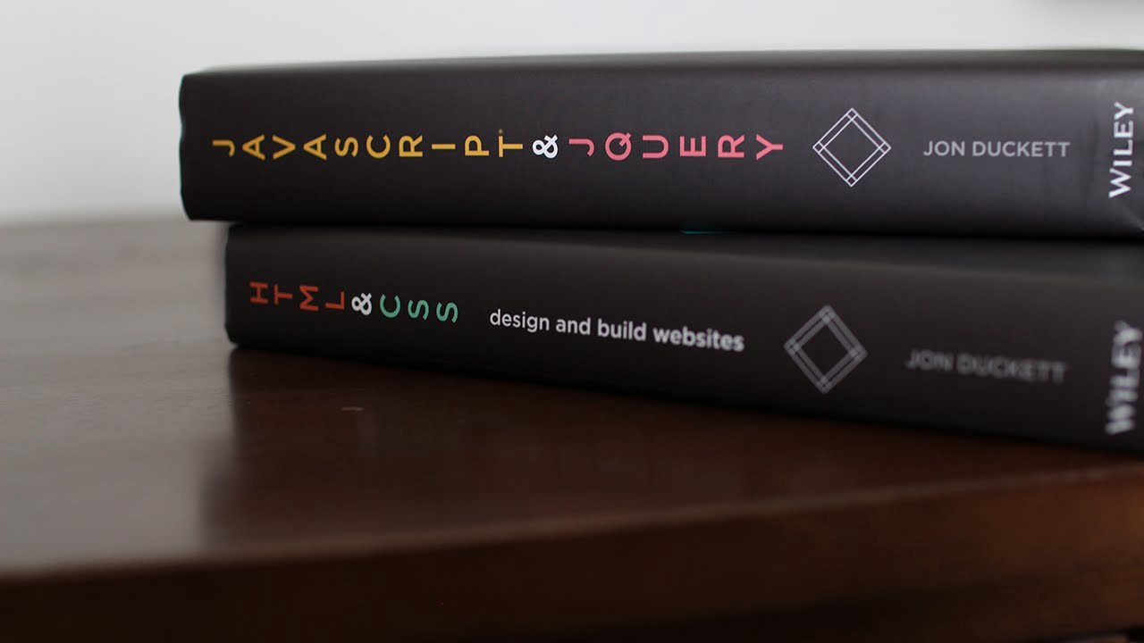 Two books in the Introduction to Web Development series on a table on top of each other