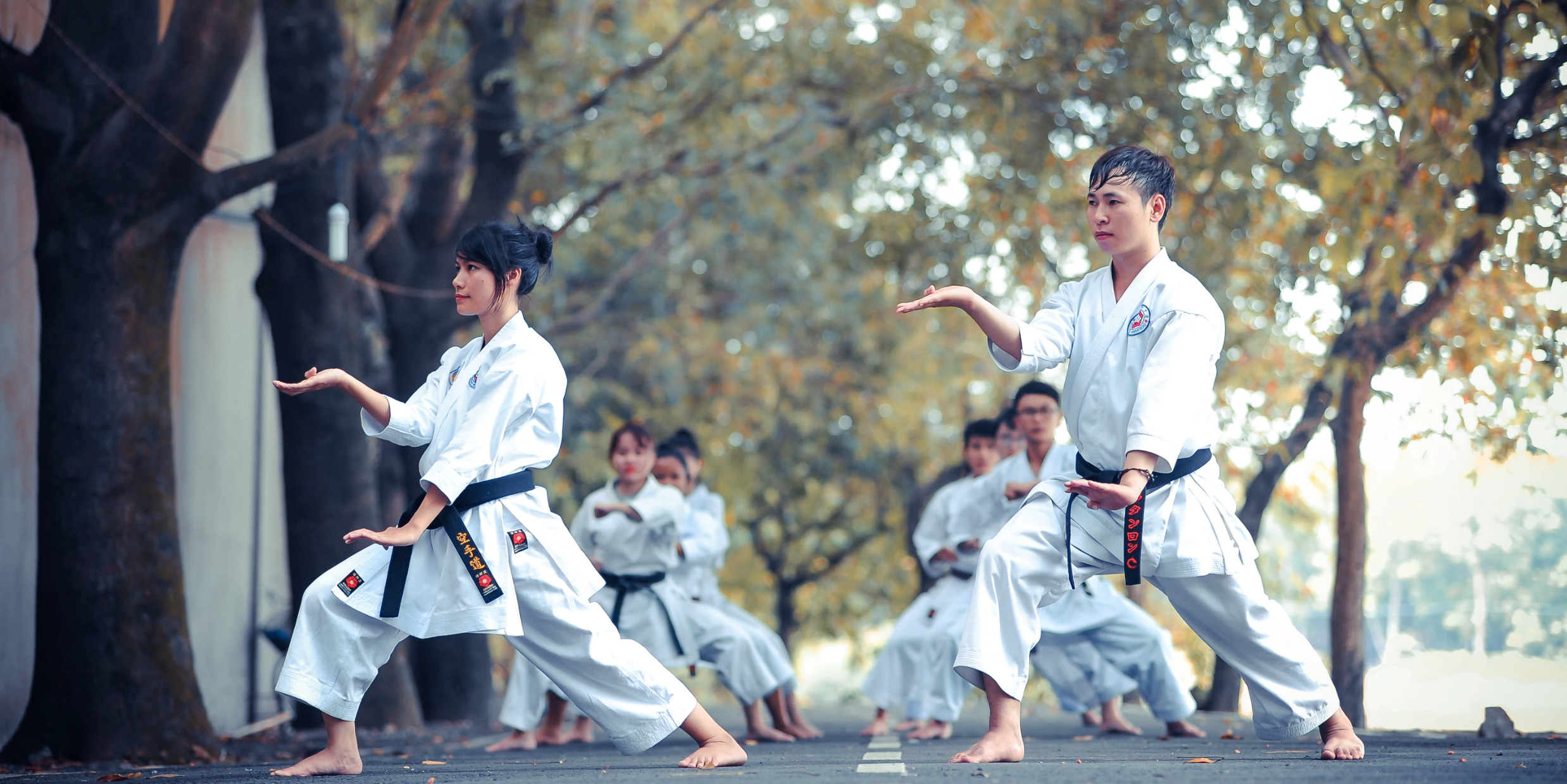 Young Karate practitioners performing the moves on the street