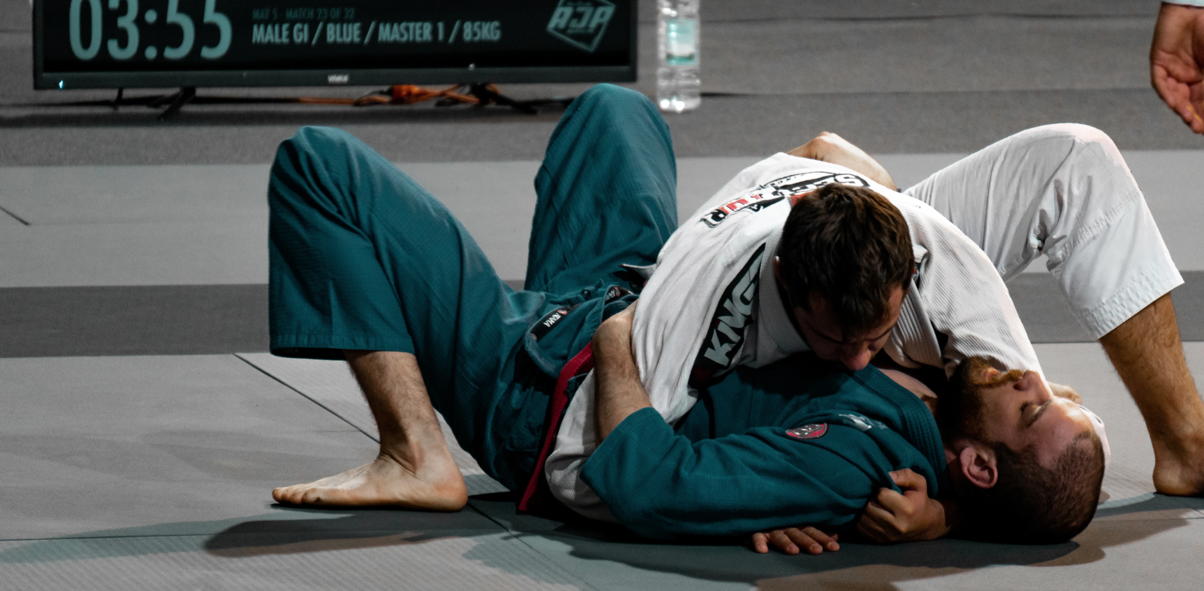 Two Judokas performing the grappling exchanges on the mat