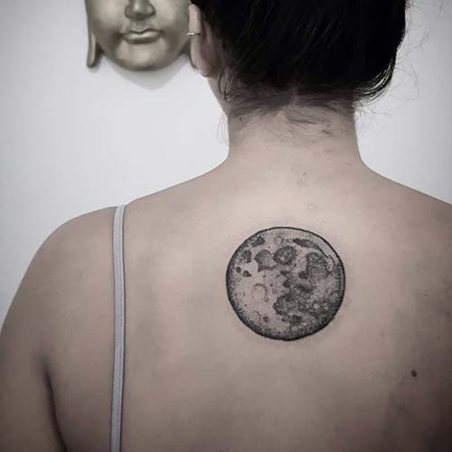 woman back fullmoon tattoo