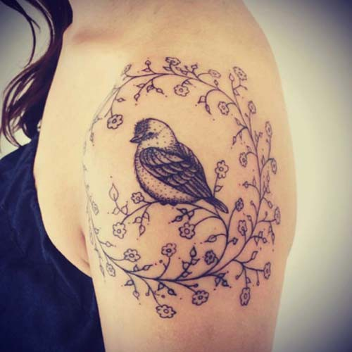 single bird woman shoulder tattoos