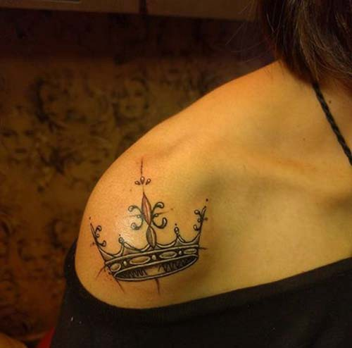 woman shoulder crown tattoo