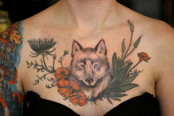 wolf tattoo on female chest