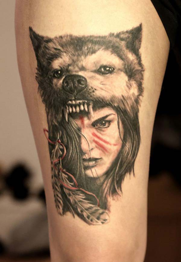 wolf and girl arm tattoo
