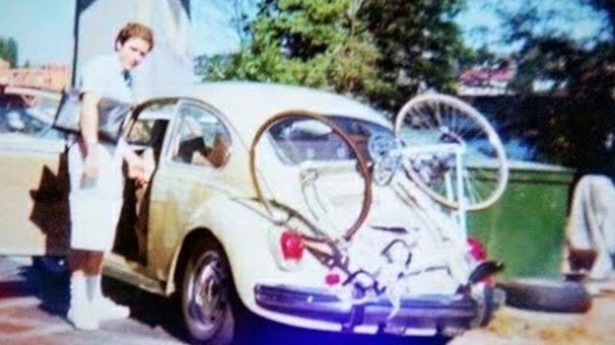 Ted Bundy in a picture with his infamous yellow Volkswagen Beetle he used to abduct young women.
