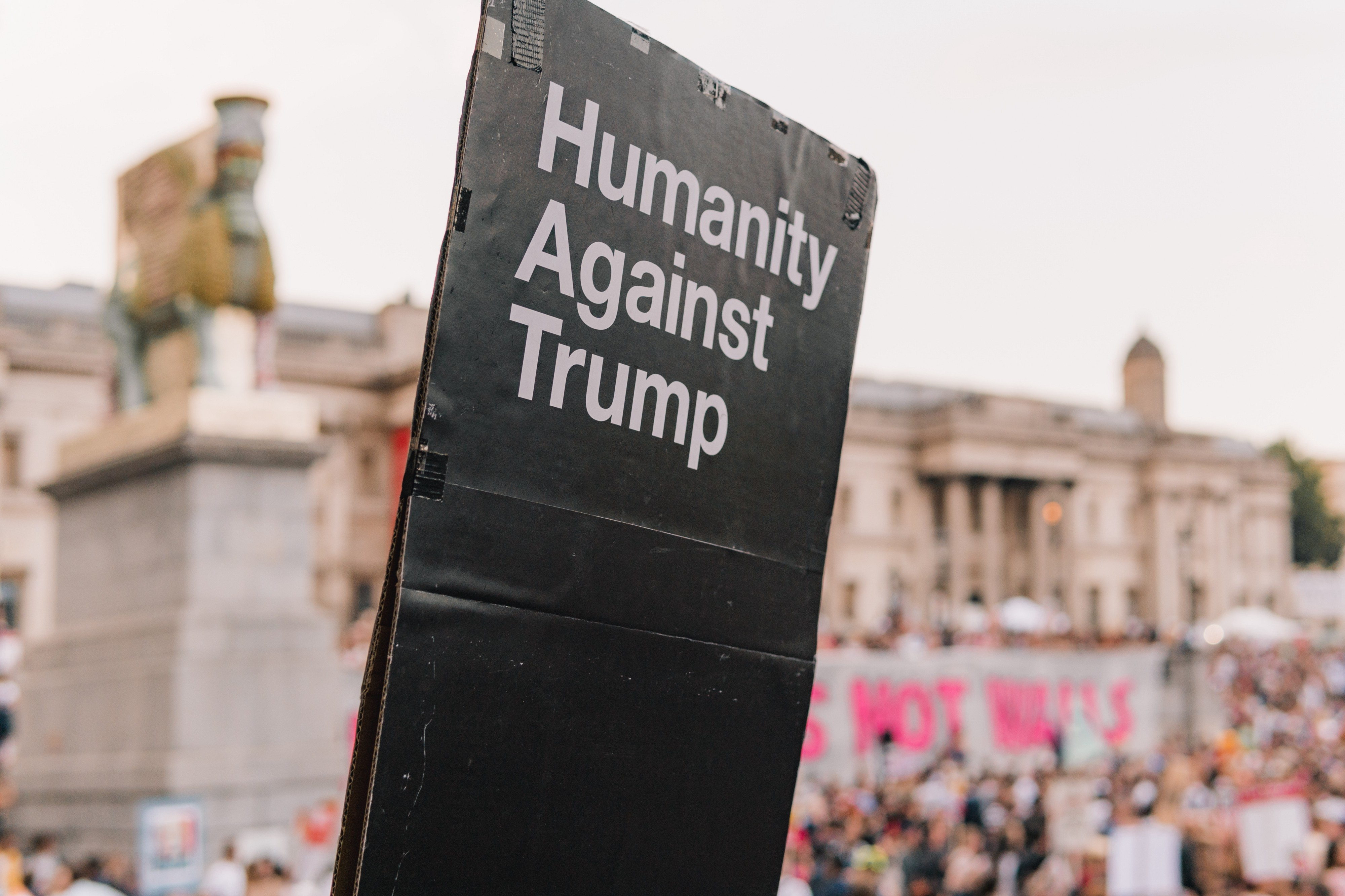 A photo of a protest sign that says, ?humanity against Trump.?