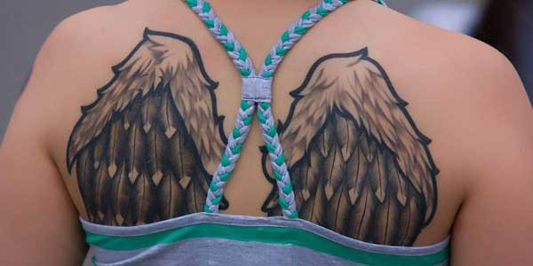 wings tattoo for woman beck