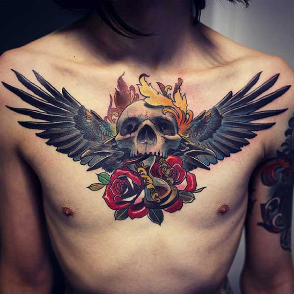 wing tattoo with skull